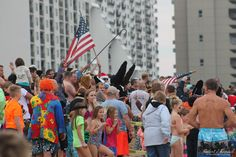 Penguin Swim 2016 Ocean City Maryland Photographs of Best Costumes, The Swimmers, The Fans and more...  #oceancitycool