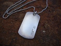 His Dog Tag Sterling Silver Personalized Hand Stamped Mens or Boys Necklace. $42.00, via Etsy.