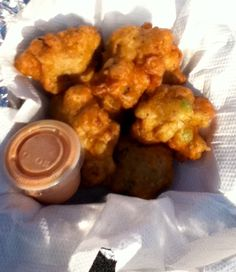 When in the Bahamas conch fritters is a MUST Conch Fritter King Conch Fritters Cajun Dishes, Tasty Dishes, Great Recipes, Dinner Recipes, Favorite Recipes, Conch Recipes, Bahamian Food, Conch Fritters, Southern Recipes