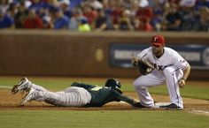 CrowdCam Hot Shot: Oakland Athletics shortstop Jed Lowrie dives back to first base as Texas Rangers first baseman Mitch Moreland catches the ball in the game at Rangers Ballpark in Arlington. Photo by Tim Heitman