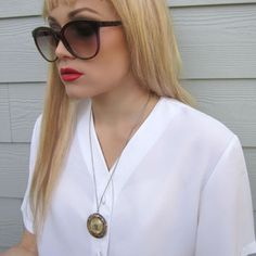 Saint Christopher Necklace. I love those shades though.