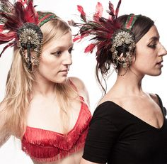 Art Nouveau Headdresses featuring red & green feathers & bronze peacock medallions.