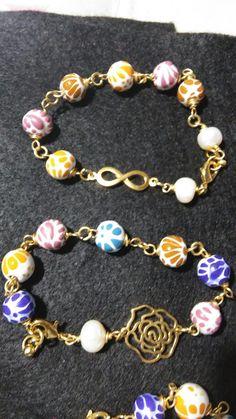 Pulsetas de talavera con oro laminafo y perlas