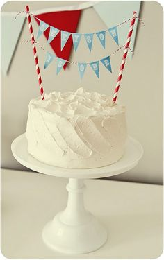DIY cake topper = two stripey paper straws and teeny tiny bunting made of paper and baker's twine. Sooooo easy!