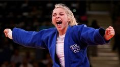 Automne Pavia of France celebrates her bronze medal over Hedvig Karakas of Hungary during the women's -57 kg Judo on Day 3 of the London 2012 Olympic Games at ExCeL.