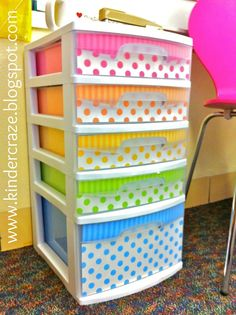 Fancy Up Sterlite Drawers by lining the inside of drawers with decorative scrapbook paper. Includes a link to purchase this cute polka dot paper :)