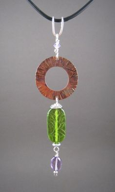 A personal favorite from my Etsy shop https://www.etsy.com/listing/220586315/handcrafted-hammered-copper-circle