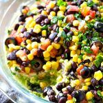 This colorful Southwestern-style taco dip will be the biggest hit of your party.---So many layers of homemade guacamole and all your favorite taco toppings! Guacamole Dip, Homemade Guacamole, Mexican Food Recipes, New Recipes, Cooking Recipes, Healthy Recipes, Skinny Recipes, Favorite Recipes, Taco Dip