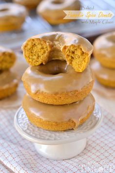 These easy Baked Pumpkin Spice Donuts with Maple Glaze are perfectly moist and bursting with flavor - the quintessential fall breakfast! | MomOnTimeout.com | #pumpkin #donut #doughnut #breakfast #recipe #IDelight