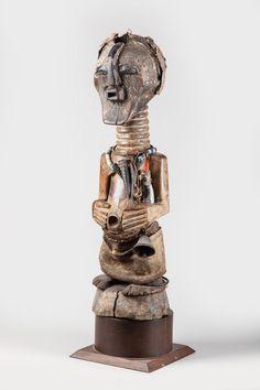songye nkisi wearing a kifwebe