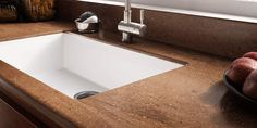 What many don't know is that the kitchen sink can be made from the same material your countertops are made from, yielding a completely seamless design from countertop to sink.
