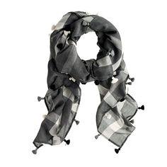 """We combined two of our favorite things—plaid and tassels—to make this playful scarf.  <ul><li>50""""L x 45""""W.</li><li>Cotton/silk.</li><li>Dry clean.</li><li>Import.</li></ul>"""