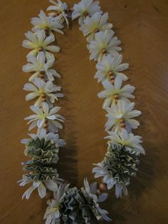 Single orchid butterfly money lei fresh flower lei these are pre white silk daisies and wood beads money lei mightylinksfo