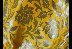 This is a beautiful pure banarsi silk brocade floral design fabric in Yellow and Gold. The fabric illustrate woven roses on Yellow background.  You can use this fabric to make Dresses, Tops,...