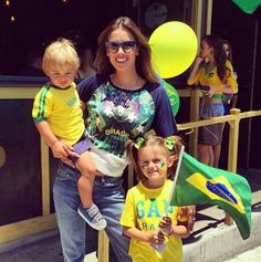 Supermodel mom Alessandra Ambrosio supports the Brazilian team in style with her two beautiful kids == www.pretamama.com Pret a Mama, for fashion mommy and mini