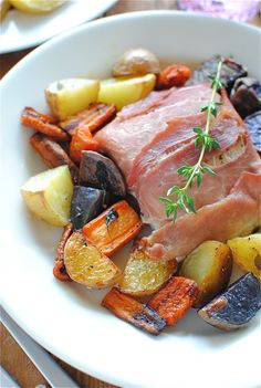 Prosciutto-wrapped salmon with roasted vegetables...I don't love Salmon, but would totally enjoy it this way!