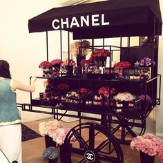 Everyone should have a Chanel flower cart in their backyard!