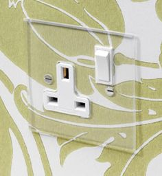 invisible / transparent plate switches, dimmers and sockets from Forbes & Lomax, pictures