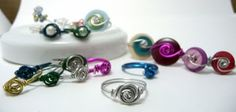 I made my first one in under 10 minutes.   Shealynn's Faerie Shoppe: Wirewrapped Rosette Ring { Tutorial }