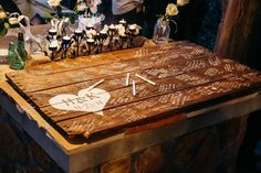 DIY guest book made with rustic boards and white sharpies at Hadley and Kodi's Vintage Rustic Georgia Wedding at Fritz Farm. TR Photography