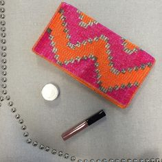 Forever 21 Colorful Beaded Clutch Bright, bold orange, magenta and silver beaded clutch is not for the faint of heart! This unique show stopper is the perfect accompaniment to any evening. Lightweight and easy to carry for a statement outfit. Magnetic snap keeps your things secure, and slim interior pocket can keep your driver's license organized for easy access. Forever 21 Bags Clutches & Wristlets
