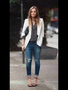 Black and white polka dot shirt, white blazer.