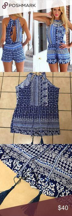 Chic Tassel waist Tie Open Back Romper Chic blue Romper with detailed print, waist tie w/ tassel, Sleeveless and deep open back w/ tie at top with tasseled detailing. Shorts