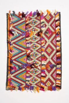 this is a pretty plain rug, low rug (if you ignore the pattern and just look at the pile) BUT the thing that makes it really interesting is that they've just stitched on some trim - great idea!