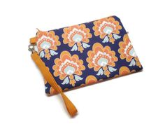 A personal favorite from my Etsy shop https://www.etsy.com/listing/253293639/orange-and-navy-retro-style-damask