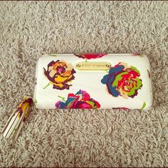 Betsey Johnson Floral Zip Leather Wallet Soft ivory with vibrant flowers. Great condition, barely used. Inside is pristine. Sweet wallet by the queen of cool, BJ. Betsey Johnson Bags Wallets
