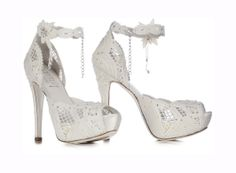 LORIBLU. Ivory pillow lace jewel sandal with platform. Delicate and lovely sandal, this model is featuring a pillow lace working enhanced by a sparkling shower of hand-applied SWAROVSKI ELEMENTS. A real object of desire!  Available at Loriblu boutiques and http://www.loriblu.com/en/sposa/sposa-calzature/sandalo-gioiello-3ep12047pff6746c.html