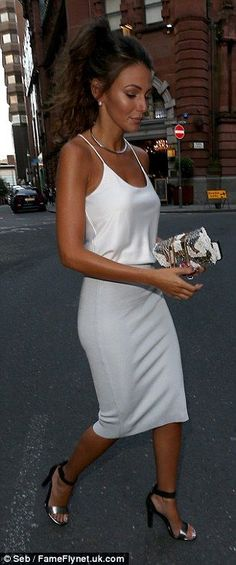 Michelle Keegan in a gorgeous camisole & pastel blue pencil skirt looking stunning as always & bang on trend for SS14...x
