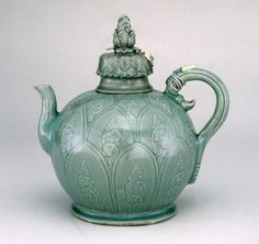 Celadon Ewer. Korea. Koryŏ dynasty, first half of the 12th century. Stoneware with white and black slip decoration and blue-green glaze