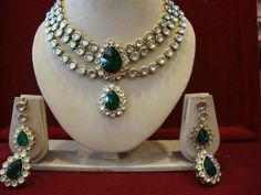 TRIPLE DIAMOND AND EMERALD STRING SET -   Zircon and Emerald studded Necklace Set with Matching Earrings - Price  $89.00 - Description  Triple string zircon studded necklace set with artificial emerald pendent and a pair of matching earrings styled with an emerald drop. #Jewelry