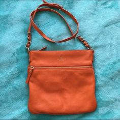 Kate Spade Crossbody Kate Spade Cobble Hill Ellen crossbody. Beautiful orange color for the spring! In great condition except for a white spot on the back. I have no idea what caused it, and don't know if it could be cleaned with a leather cleaner (when you're wearing the purse the spot can't be seen). Comes with dust bag. kate spade Bags Crossbody Bags