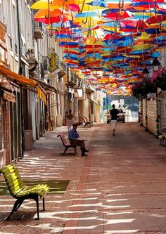 Looks like they've done it again! The city of Agueda, Portugal has once again decorated some of their streets with colorful canopies of umbrellas! Flickr photographer Patrícia Almeida took these great shots of them last year, which went viral. The installation was part of an art festival called Agitagueda. Portuguese design firm Studio Ivotavares had created the cheery installation to turn traditional shopping streets into an engaging visual experience.