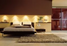 modern master bedroom- i like the wood accent with the lights coming down
