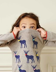 WELL STYLED: The simple interior, panelling creating an air of sophistication and heritage but the pose of the girl contrasts with this since its cheeky and playful Festive Jumpers, Cute Jumpers, Christmas Jumpers, Christmas Sweaters, Mini Boden, Boden Uk, Christmas Jumper Day, Christmas Gifts For Girls, Christmas Baby
