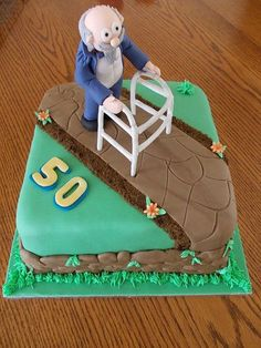 A 50th birthday cake idea featuring a sneak peek of Grandpa on a walker. See more 50th birthday cakes and party ideas at www.one-stop-party-ideas.com