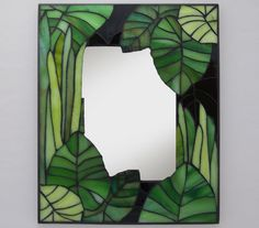 just greens mirror - Step out into nature with this small, whimsical mosaic mirror that emulates the lush growth of a garden in high summer.- my urbanware Mosaic Crafts, Mosaic Projects, Stained Glass Projects, Stained Glass Patterns, Mosaic Patterns, Stained Glass Mirror, Mirror Mosaic, Mosaic Art, Mosaic Glass