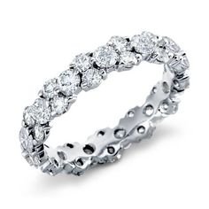 Perfectly stunning, this diamond eternity ring features round diamonds prong-set in pairs and singles creating a continuous band.
