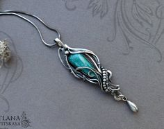Elegant silver pendant Amazonie with beautiful natural amazonite. Its the pendant-transformer: pendant, necklace and also it can be a brooch fibula) The pendant can be worn in different ways, a drop and pendant holder are removable and can be swapped or . This pendant can be a wonderful addition to your image, as well as a memorable gift! Сompletely handmade! Length with all the details 71mm (2.8) Width 20mm (0,7) Weight 7,4 g The chain of 45-50 cm (17.5...19.5) included in the price, The…