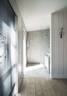 On the southern part of Gothland Island in Sweden, this new home manages to slip seamlessly into its rugged surroundings thanks to a thoughtful design by Martina Eriksson of m. Smooth Concrete, Tin House, Timber Buildings, Exterior Cladding, Building A New Home, White Paneling, Rustic Outdoor, Interior Design Studio, Coastal Homes