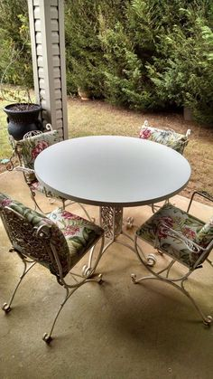 Vintage Patio Table Set With Four Chairs And Shelf Made From Heavy Wrought  Iron