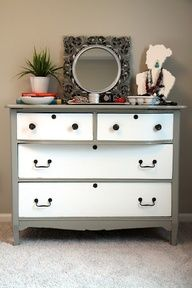 I like the grey contrast with the white draws. Ideas for our entertainment dresser!