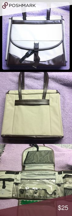 """Mimi organizer NWOT Has reinforced structure that is padded & then covered in a tan Durable 600 Denier Water Resistant Fabric, all stitched-no glue. Double, over-the-shoulder,""""MIMI"""" Memories in Motion Ex. Measurements :Closed : 14½""""Wx 13""""H x 3+""""w/ a variety of clear vinyl pockets, net pockets, secure velcro & zipper closures, & multiple pen & scissor loops, All stitched-no glue. Interior Measurement: Fully opened 38"""" wide x 38"""" tall (More than 3 feet x 3 feet). Mimi (Memories in Motion) Bags"""