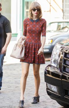 Stepping out: Taylor looked delightful in the cinnamon red knitted frock with navy flat collar 2