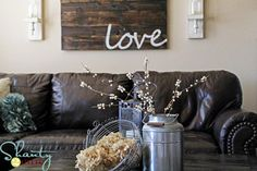 pallet art...love the milk jug on the coffee table!