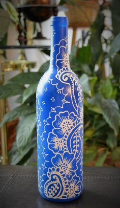 Enjoy this beautiful, hand painted wine bottle that will add warmth to any home décor. Each vase is handcrafted making them all uniquely, one of a kind! These henna inspired wine bottle vases are wonderful as gifts for any occasion, or just as a beautiful addition to your home. Use them as center pieces on a table of choice, or place them in a kitchen window seal where adding fresh flowers will bring a delightfully fresh aroma to your home.  Artificial flowers do not come with the purchase…