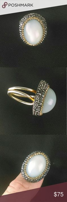 Genuine Moonstone 14K Gold Vermeil Large Ring This is a stunning Native Gem genuine large moonstone adjustable ring with gunmetal and gold crystal embellishment. 925 sterling Silver with 14K gold vermeil plating. The plating is done in a way that gives a vintage appearance.   Moonstone is gorgeous and is said to have healing and magical powers. This ring adjust from size 5 - size 9.  I purchased this ring brand new and it comes in box. Native Gem Jewelry